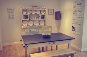 Slate Top Table, bench and mismatched chairs in a neutral dining room