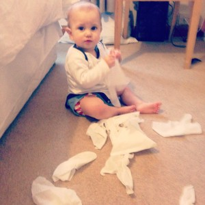 baby destroying a packet of baby wipes!