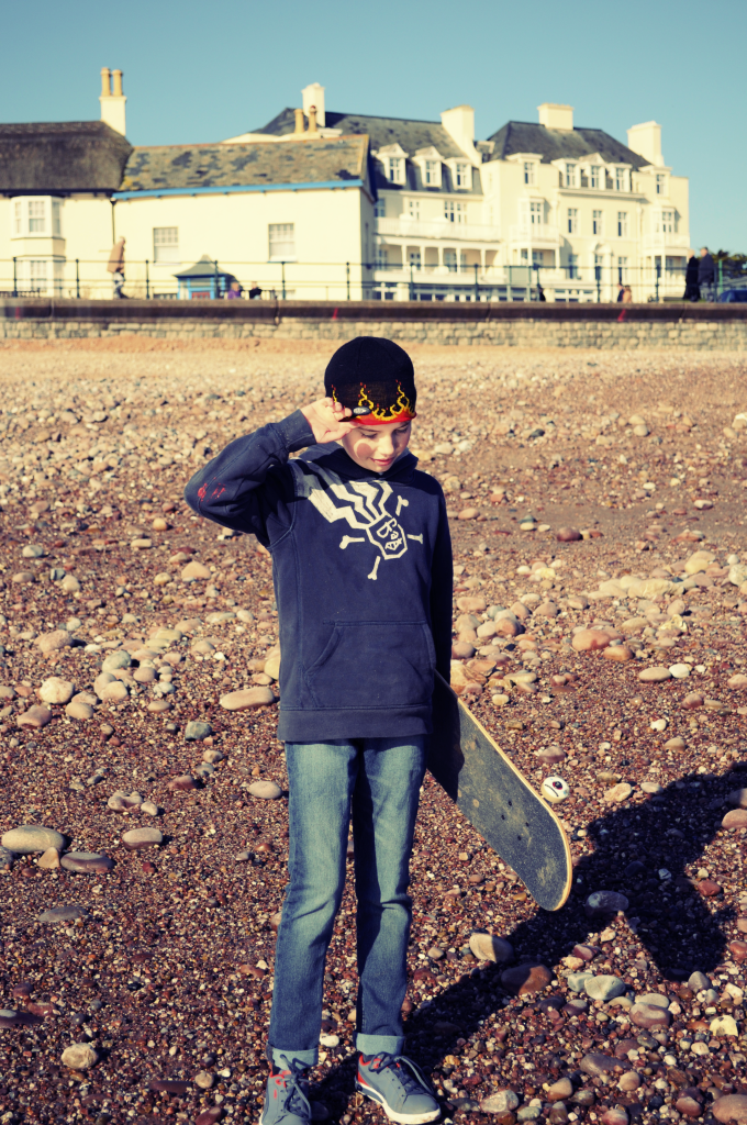 skateboarding on Sidmouth seafront on our sunny Winter beach stroll by Mum in a nutshell