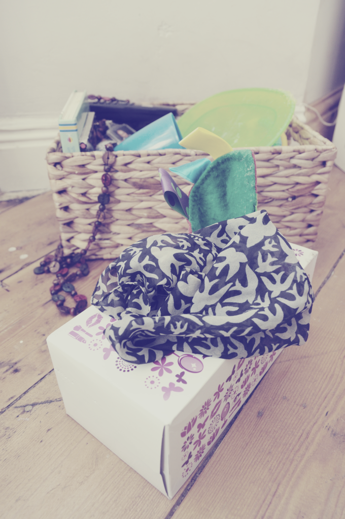 tissue box filled with scarves for baby and toddler play ideas. heuristic play and treasure baskets