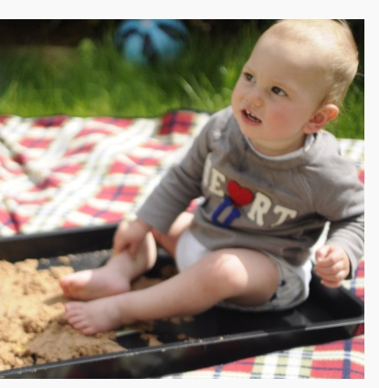 Sunny day & a homemade sand pit