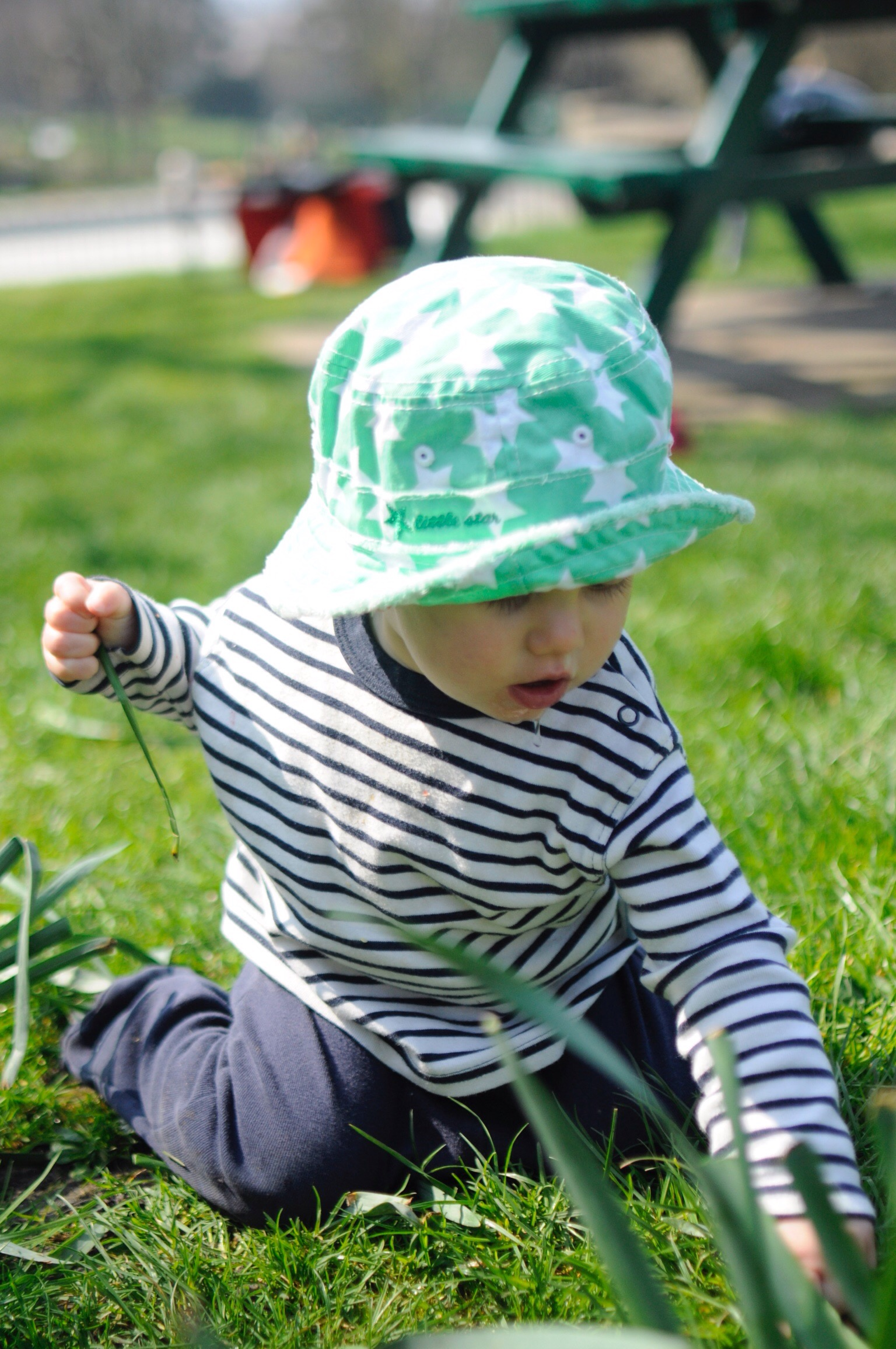 Baby's first crael in the park playing with the grass, a full sensory play session Al Fresco