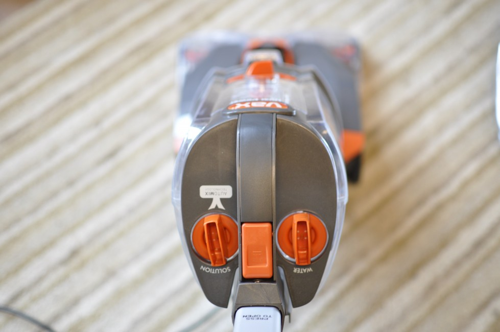 At first glance, it looks like an ordinary upright vacuum cleaner. Making it easier to store, that's quite a big factor for me as there's very little storage space left in the Nutshell crib. It works by filling the upper tank with water and cleaning solution (which is provided) and running over your carpets with the solution and then again with the suction switched on. It as simple as that. If you're wondering whether washing carpets is really necessary, surely a decent vacuum cleaner will do the job effectively, just by going over with a Vax Duel Power pro will let you know all you need. It's actually quite embarrassing when you see the colour of the liquid being lifted from what you think is a perfectly clean carpet. To think that my toddler plays on that, and the Tween and Teenager will lie down and watch movies. I always like to think I'm a clean person and I can keep the wooden floors hygienic with a mop and steamer, but just seeing the difference that a carpet washer makes has made me realise that all was not as it seems!