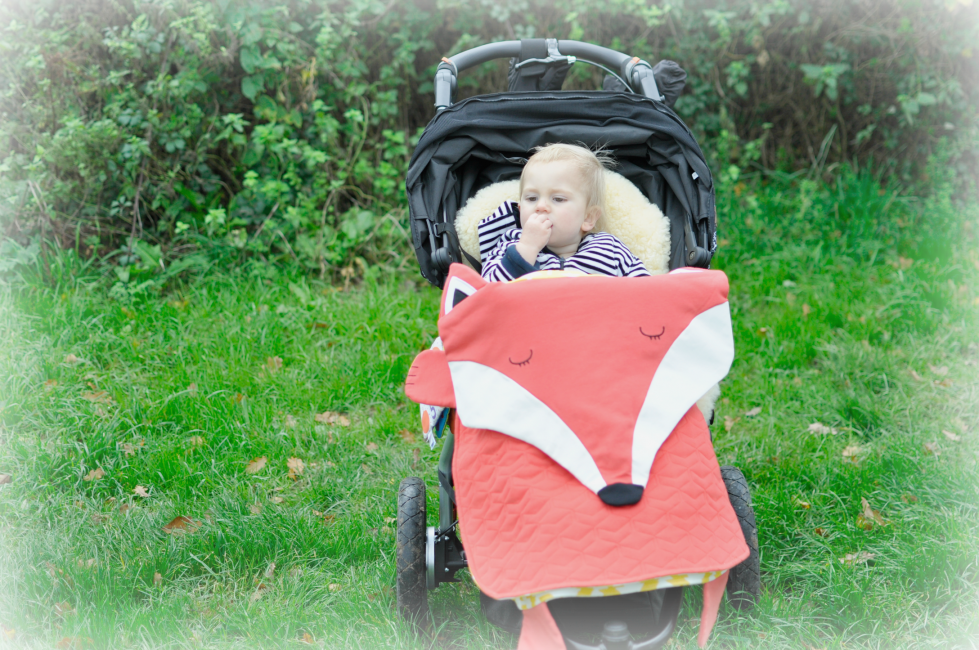 The Period from Oribel has many uses, here we're using it as a pushchair blanket, read more uses here;